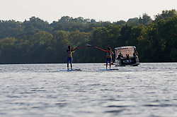 Paddle-boarders perform on the Schuylkill River as part of the final performance of the 2015 Invisible River Festival on Saturday. (Bastiaan Slabbers/for PhillyVoice)