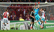 Real Madrid's   Iker Casillas vies with Ajax Amsterdam's  during the UEFA Champions League Group D football match Ajax Amsterdam vs Real Madrid on October 3, 2012 AFP PHOTO/ ROBIN UTRECHT.