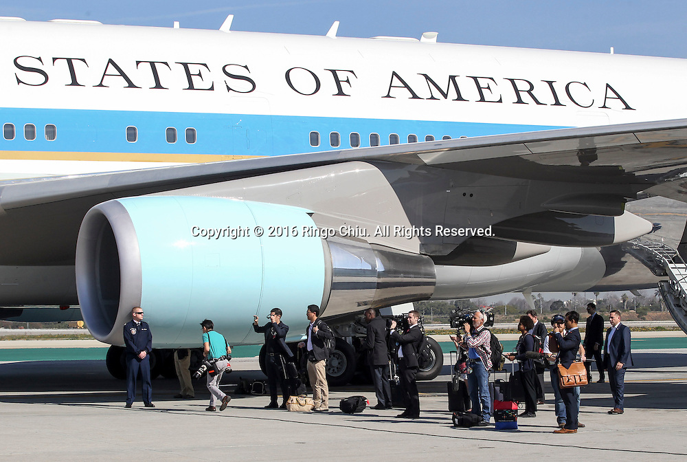 Members of the White House media travel pool cover President Barack Obama boarding Air Force One at Los Angeles International Airport in Los Angeles, Friday, Feb 12, 2016.(Photo by Ringo Chiu/PHOTOFORMULA.com)<br /> <br /> Usage Notes: This content is intended for editorial use only. For other uses, additional clearances may be required.