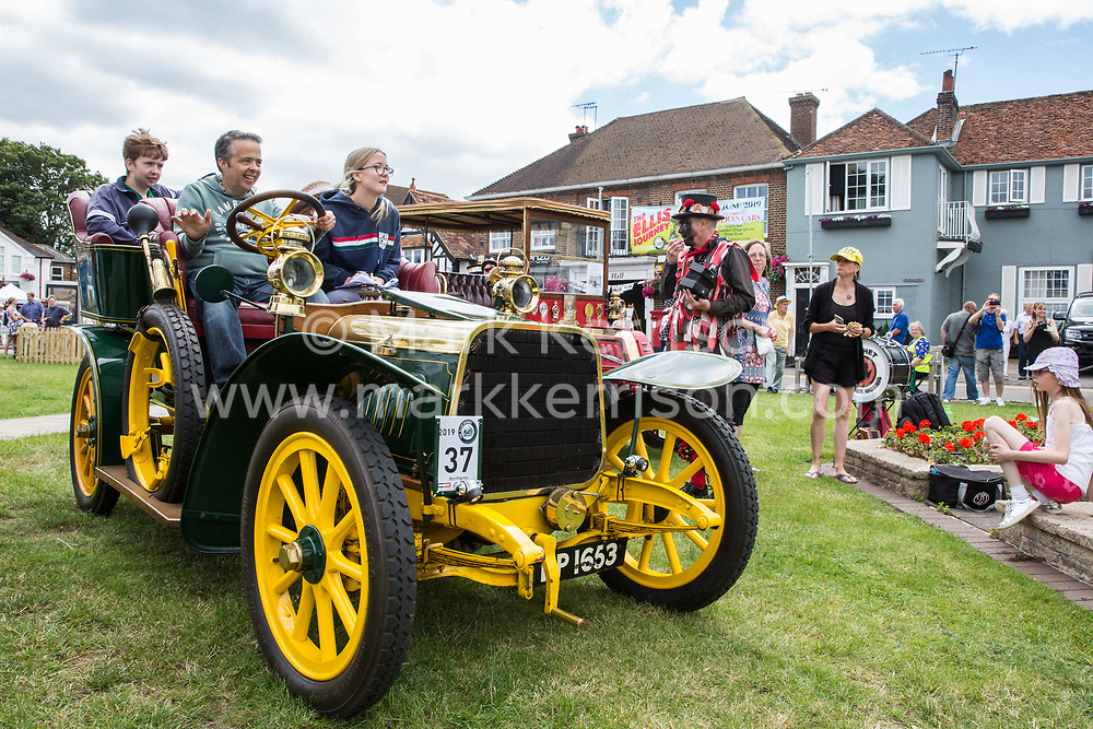 Datchet, UK. 30 June, 2019. Datchet Border Morris welcome a pre-1905 vehicle as it completes the 48-mile Ellis Journey from Micheldever station near Winchester to Datchet. The Ellis Journey is a reenactment of the first recorded journey by a motorised carriage in England undertaken by pioneer automobilist Hon. Evelyn Ellis in his new, custom-built Panhard-Levassor on 5th July 1895.