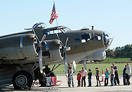 Montgomery, New York - People line up to climb inside a B-17 Flying Fortress bomber at Orange County Airport on Oct. 2, 2010. Three World War II planes from the Collings Foundation were on display and available for tours and flights at Orange County Airport on Oct. 2, 2010.