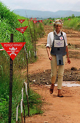 "Embargoed to 0001 Monday August 21 File photo dated 15/01/97 of Diana, Princess of Wales, touring a minefield in body armour during her visit to Angola. Diana, Princess of Wales was a woman whose warmth, compassion and empathy for those she met earned her the description the ""people's princess""."