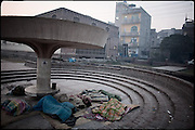 """Young boys, homeless and drug users, sleep on the ground, just in front an rehabilitation center for addicts people. Heera Mandi, Lahore, Pakistan, on monday, December 01 2008.....""""Pakistan is one of the countries hardest hits by the narcotics abuse into the world, during the last years it is facing a dramatic crisis as it regards the heroin consumption. The Unodc (United Nations Office on Drugs and Crime) has reported a conspicuous decline in heroin production in Southeast Asia, while damage to a big expansion in Southwest Asia. Pakistan falls under the Golden Crescent, which is one of the two major illicit opium producing centres in Asia, situated in the mountain area at the borderline between Iran, Afghanistan and Pakistan itself. .During the last 20 years drug trafficking is flourishing in the Country. It is the key transit point for Afghan drugs, including heroin, opium, morphine, and hashish, bound for Western countries, the Arab states of the Persian Gulf and Africa..Hashish and heroin seem to be the preferred drugs prevalence among males in the age bracket of 15-45 years, women comprise only 3%. More then 5% of whole country's population (constituted by around 170 milion individuals),  are regular heroin users, this abuse is conspicuous as more of an urban phenomenon. The substance is usually smoked or the smoke is inhaled, while small number of injection cases have begun to emerge in some few areas..Statistics say, drug addicts have six years of education. Heroin has been identified as the drug predominantly responsible for creating unrest in the society."""""""