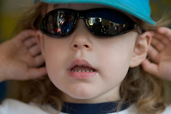 Portrait of a young girl wearing sun glasses,