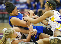 Coeur d'Alene High's Kendalyn Brainard gets caught in the middle of Karlee Wilson, left, and Chelsea Water from Lewiston High as they fight for a loose ball.