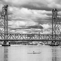A lone kayaker looks up to the soon to be torn down 90-year-old Memorial Bridge in Portsmouth, NH.<br />