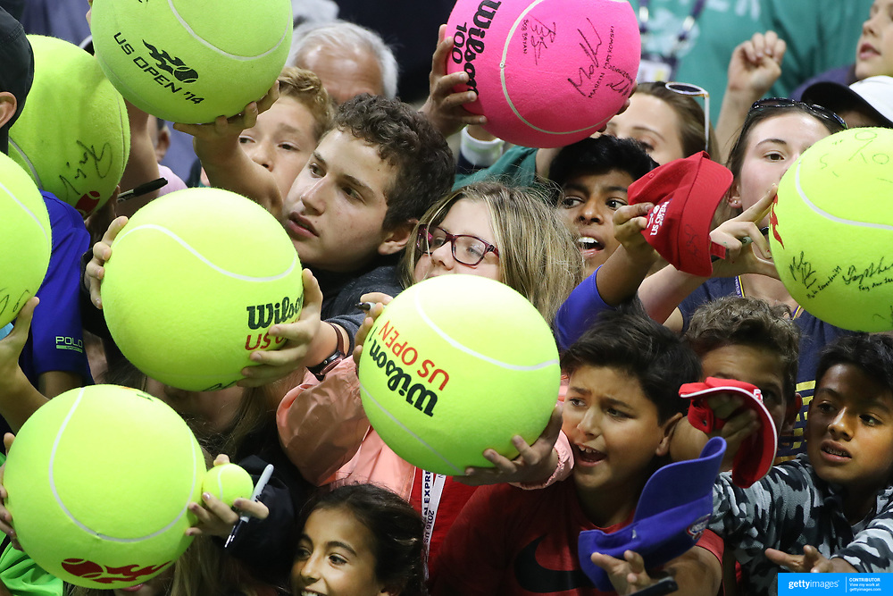 2017 U.S. Open Tennis Tournament - DAY SEVEN. Young fans wait for the chance of an autograph from Venus Williams of the United States after her win against Carla Suarez Navarro of Spain during the Women's Singles round four match at the US Open Tennis Tournament at the USTA Billie Jean King National Tennis Center on September 03, 2017 in Flushing, Queens, New York City.  (Photo by Tim Clayton/Corbis via Getty Images)