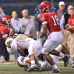 Dec 19, 2009; St. Petersburg, Fla., USA; UCF defensive back Josh Robinson (20) tackles Rutgers wide receiver Mohamed Sanu (6) during NCAA Football action in Rutgers' 45-24 victory over Central Florida in the St. Petersburg Bowl at Tropicana Field.