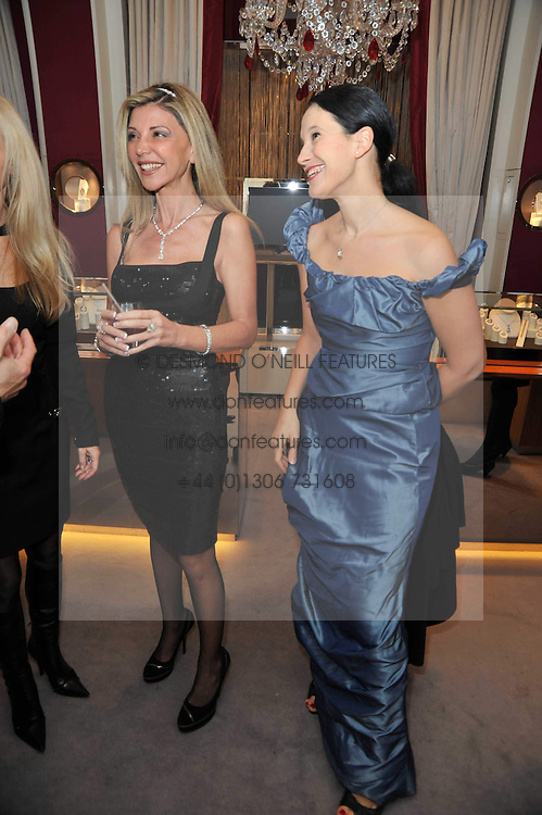 Left to right, LISA TCHENGUIZ and OLGA BALAKLEETS at a party to launch the Georgina Chapman collection for Garrard held at Garrard, Albermarle Street, London on 4th November 2009.