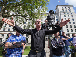 © Licensed to London News Pictures . 27/05/2013 . London , UK . EDL Deputy Leader , KEVIN CARROLL , remonstrates with anti-fascist protesters in front of the statue of Field Marshal Bernard Law Montgomery on Whitehall . The EDL march along Whitehall and hold a demonstration opposite Downing Street today (Monday 27th May 2013) . Photo credit : Joel Goodman/LNP