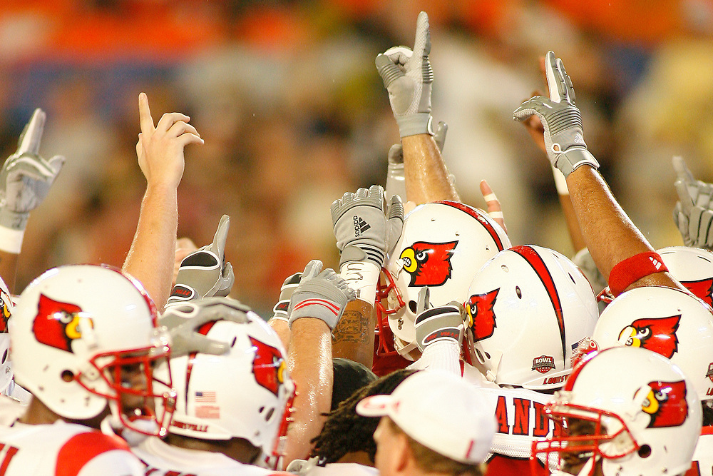 Many University of Louisville players join together and raise their fingers before the Louisville Cardinals 24-13 victory over the Wake Forest Demon Deacons at the 2007 Orange Bowl Game on January 2, 2007 at the Dolphin Stadium in Miami, Florida.
