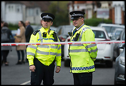 April 28, 2017 - London, England, United Kingdom - Police guard the scene on Harlesden Road, Willesden, north-west London, where a woman  was shot during a terror raid yesterday evening. A woman in her 20s was shot by counter-terror officers in the raid after 7pm on Thursday. (Credit Image: © Ben Stevens/i-Images via ZUMA Press)