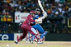 © Licensed to London News Pictures. 29/09/2012. Sri Lankan Kumar Sangakkara batting during the T20 Cricket World super 8's match between Sri Lanka Vs West Indies at the Pallekele International Stadium Cricket Stadium, Pallekele. Photo credit : Asanka Brendon Ratnayake/LNP