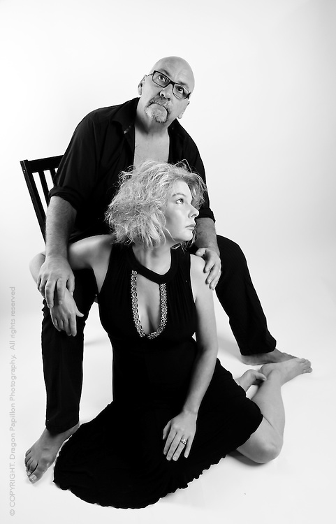 black and white full length studio portrait of couple dressed in black