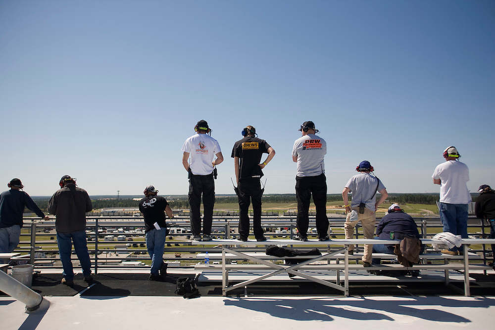 Track spotters at work on top of the viewing stands at Rockingham Speedway, Friday, April 17, 2009.