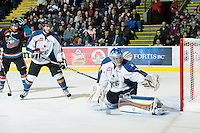 KELOWNA, CANADA, NOVEMBER 25: Jagger Dirk #5 of the Kootenay Ice stands in front of the net of Nathan Lieuwen #31 of the Kootenay Ice as the Kootenay Ice visit the Kelowna Rockets  on November 25, 2011 at Prospera Place in Kelowna, British Columbia, Canada (Photo by Marissa Baecker/Shoot the Breeze) *** Local Caption *** Jagger Dirk; Colton Sissons; Nathan Lieuwen;