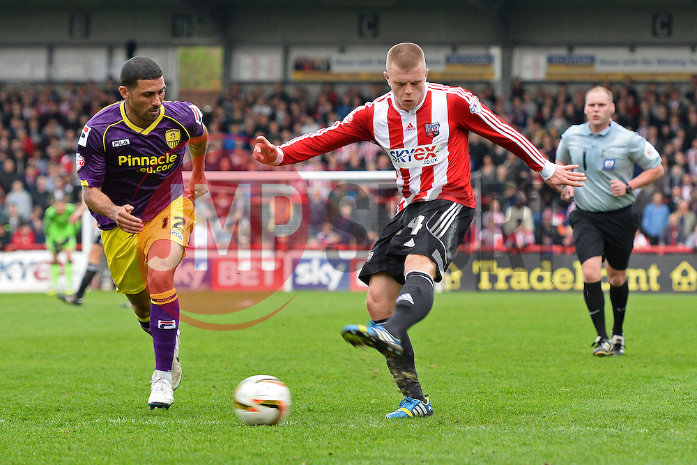 Notts County's midfielder Hayden Mullins looks on as Brentford's defender Jake Bidwell takes a shot at goal   - Photo mandatory by-line: Mitchell Gunn/JMP - Tel: Mobile: 07966 386802 05/04/2014 - SPORT - FOOTBALL -  Griffin Park - London - Brentford v Notts County- Sky Bet League One
