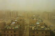 During a sandstorm in March 2003, and the USA invasion of Iraq, Kuwait City, Kuwait, gets blasted by high winds laden with desert sand from the north. (Supporting image from the project Hungry Planet: What the World Eats.).