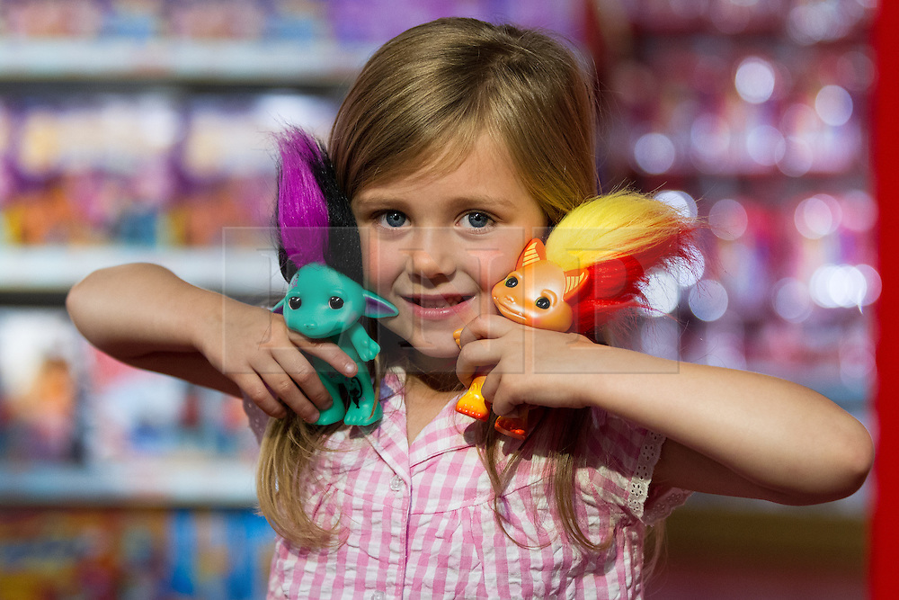 © Licensed to London News Pictures. 27/06/2013. London, UK. Lottie, 5, is seen with a pair of 'Zelf' dolls (Hamleys price GB£9) at the Christmas in June press event at Hamleys toy shop in London today (27/06/2013).  Held in retailers world famous Regents Street store, the event showcases the predicted top toys for Christmas 2013. Photo credit: Matt Cetti-Roberts/LNP