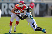 Kansas City Chiefs tight end Anthony Fasano (80) is tackled by Jacksonville Jaguars outside linebacker Geno Hayes (55) during the Chiefs 28-2 win over the Jacksonville Jaguars at EverBank Field on Sept. 8, 2013 in Jacksonville, Florida. The <br /> <br /> ©2013 Scott A. Miller