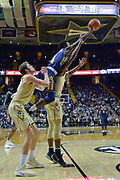 Kent State Golden Flashes guard Antonio Williams (4) leaps to shoot over Vanderbilt Commodores guard Maxwell Evans (3) during the second half of an NCAA basketball game in Nashville, Tenn., Friday, Nov. 23, 2018. Kent State won 77-75. (Jim Brown/Image of Sport)
