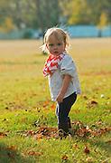 Young girl (toddler) in urban park. Manitoba
