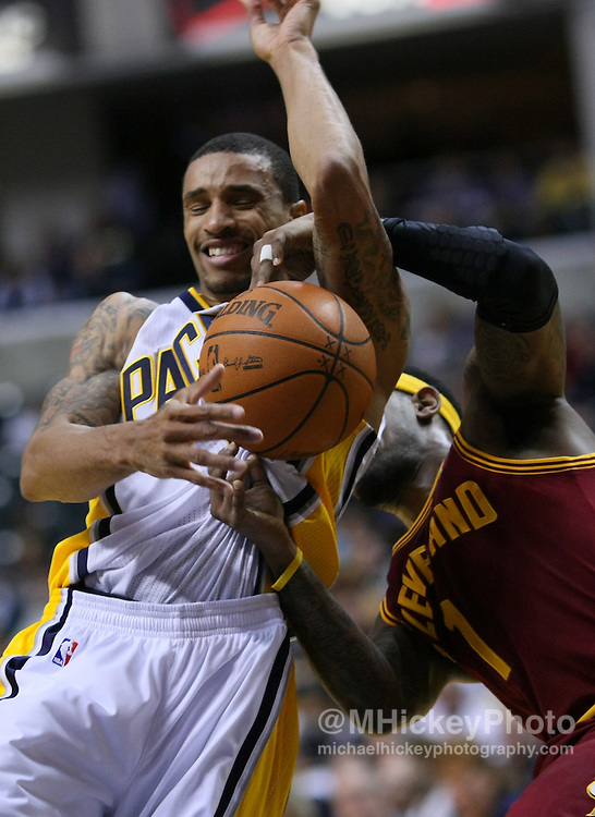Dec. 30, 2011; Indianapolis, IN, USA; Indiana Pacers point guard George Hill (3) fights for the ball with Cleveland Cavaliers point guard Daniel Gibson (1) at Bankers Life Fieldshouse. Mandatory credit: Michael Hickey-US PRESSWIRE