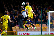 AFC Wimbledon defender Darius Charles (32) challenges for the header during the EFL Sky Bet League 1 match between Port Vale and AFC Wimbledon at Vale Park, Burslem, England on 1 April 2017. Photo by Simon Davies.