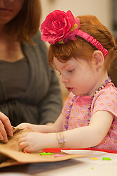 United States, Washington, Bellevue, girl (age 2) doing crafts at KidsQuest Children's Museum.  MR, PR