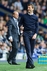 Manager Tim Sherwood (ENG) of Tottenham Hotspur smiles after his sides second goal as Manager Pepe Mel (ESP) of West Brom looks on  - Photo mandatory by-line: Rogan Thomson/JMP - 07966 386802 - 12/04/2014 - SPORT - FOOTBALL - The Hawthorns Stadium - West Bromwich Albion v Tottenham Hotspur - Barclays Premier League.