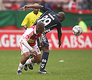 FRANKLIN CALE looses the ball to Richard Gariseb (29) during the PSL match between Ajax Cape Town and Bidvest Wits held at Newlands Stadium in Cape Town on 13 September2009 ..Photo by Shaun Roy/www.sportzpics.net.+27 21 785 6814..