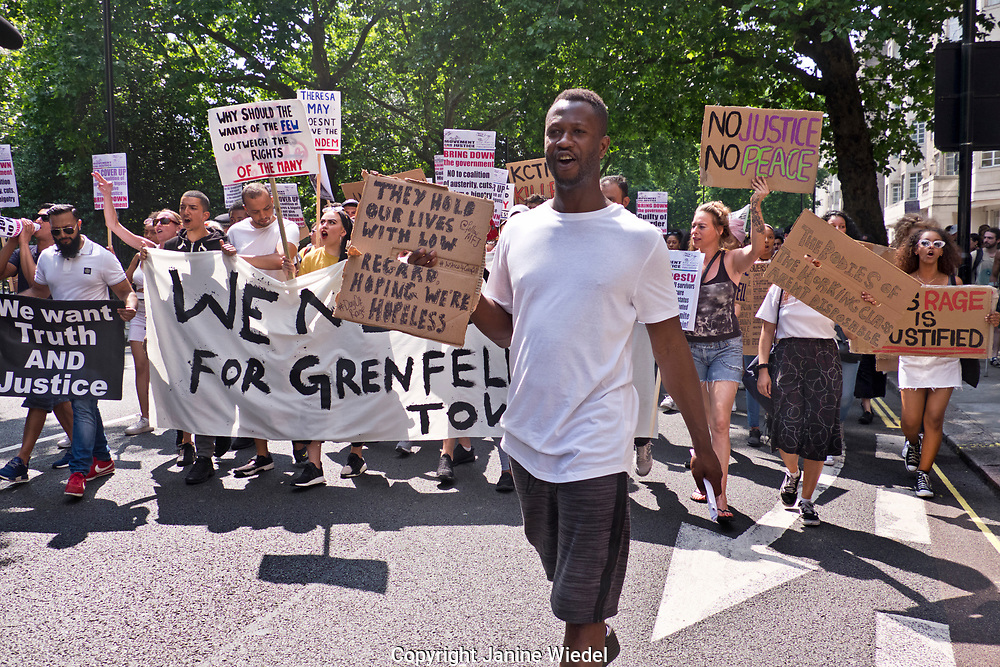 Grenfell tower march from Shephards Bush to Westminster on Day of Rage.