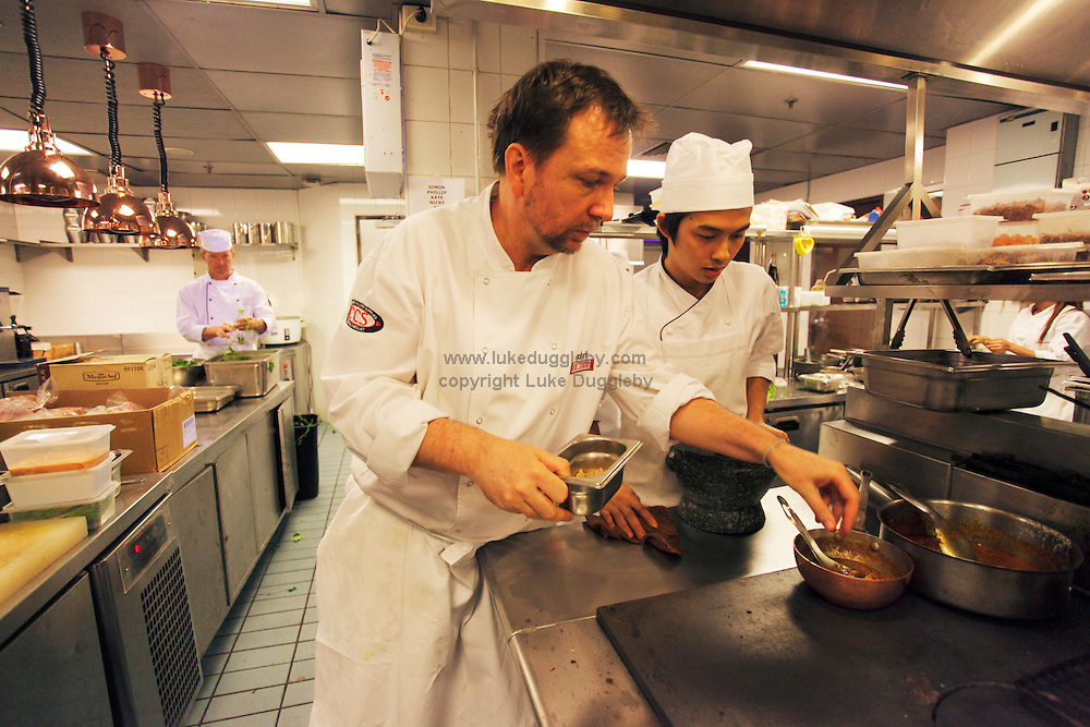 Michelin star chef David Thompson in the kitchen of his new restaurant in Bangkok called Nahm. Recently opened in Bangkok's Metropolitan Hotel and with the same name as his Michelin Star award winning London restaurant it specialises in Thai cuisine. He is renowned for opening the first ever Michelin Star winning Thai restaurant.