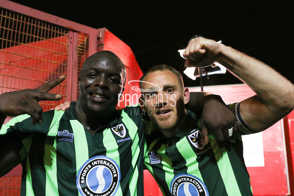 AFC Wimbledon make the final, Bayo Akinfenwa forward for AFC Wimbledon (10) and Barry Fuller (Captain) defender for AFC Wimbledon (2) celebrate after the Sky Bet League 2 play-off 2nd leg match between Accrington Stanley and AFC Wimbledon at the Fraser Eagle Stadium, Accrington, England on 18 May 2016. Photo by Stuart Butcher.