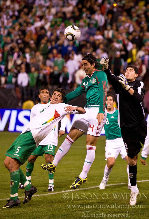 February 24, 2010; San Francisco, CA, USA;  Mexico forward Aldo De Negris (14) leaps for a header between Bolivia goalkeeper Carlos Lampe (12) and defender Santos Amador (5) during the second half at Candlestick Park. Mexico defeated Bolivia 5-0.