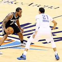 06 May 2016: Oklahoma City Thunder guard Andre Roberson (21) defends on San Antonio Spurs forward Kawhi Leonard (2) during the San Antonio Spurs 100-96 victory over the Oklahoma City Thunder, during Game Three of the Western Conference Semifinals of the NBA Playoffs at the Chesapeake Energy Arena, Oklahoma City, Oklahoma, USA.