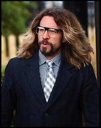 Comedian Justin Lee Collins, who is appearing in the West End show 'Rock of Ages' arrives at St Albans Magistrates Court charged with allegedly harassing a former girlfriend,  Thursday December 22, 2011. Photo by Morn/I-Images