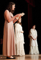 Elizabeth Bennet (Brooke Baerman) along with her mother Mrs. Bennet (Amber Hugron) and sister Jane Bennet (Chelsea Howard) take the stage during dress rehearsal for Laconia High School's production of Pride and Prejudice Tuesday evening.  (Karen Bobotas/for the Laconia Daily Sun)