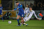 Burton Albion defender Conor Shaughnessy (16) fouling AFC Wimbledon midfielder Anthony Hartigan (8) during the EFL Sky Bet League 1 match between AFC Wimbledon and Burton Albion at the Cherry Red Records Stadium, Kingston, England on 28 January 2020.