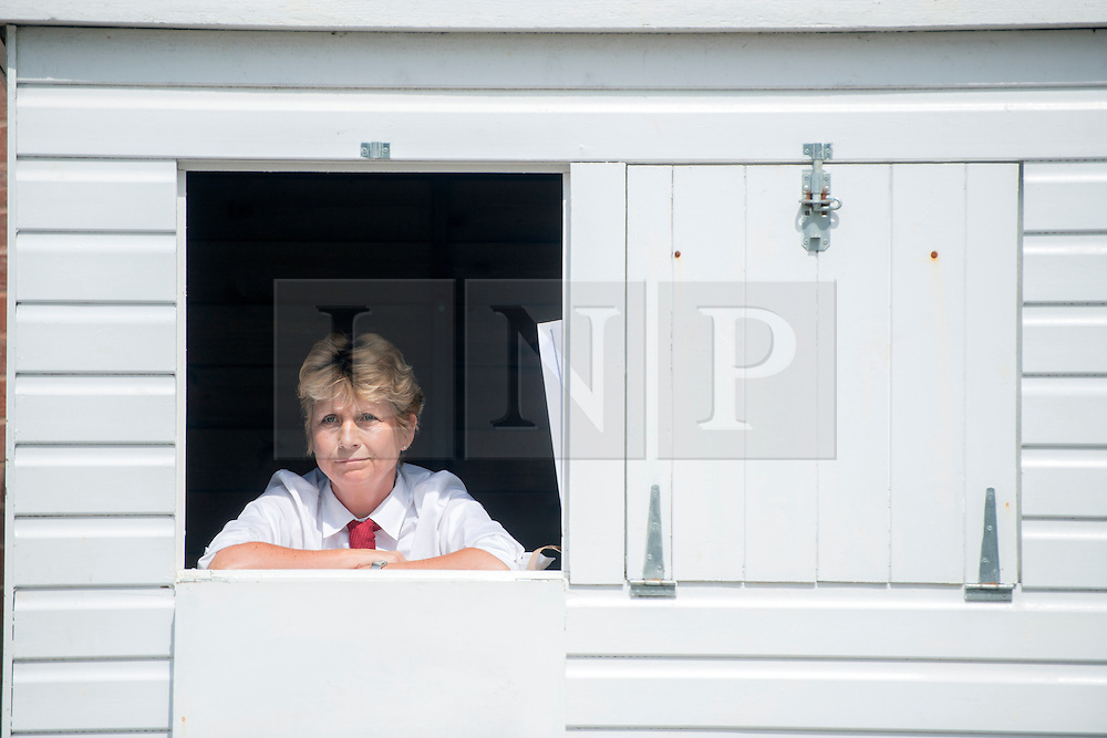 © Licensed to London News Pictures. 31/07/2014. Chichester, UK. An information clark.  Ladies Day at Glorious Goodwood at Goodwood racecourse in Chichester today 31/07/14. Photo credit : Stephen Simpson/LNP