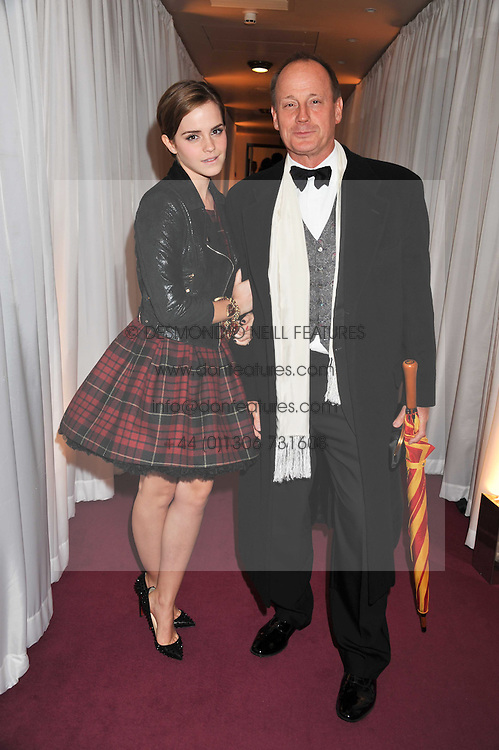 EMMA WATSON and her father CHRIS WATSON at the GQ Men of the Year 2011 Awards dinner held at The Royal Opera House, Covent Garden, London on 6th September 2011.