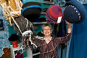 """Judith Lindenfelser knits wool hats out of Lopi, a long-fiber sheep's wool from Iceland, at her home in Chugiak, Alaska. Lindenfelser said that a hat takes approximately three hours to knit and refers to them as """"Hats With Attitude."""" The hat styles range from modern, including several with dreadlocks, to ones with a more vintage fashion reminiscent of the early 20th Century cloche style."""