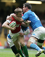 Tom Prydie of Wales is tackled by Italy's Josh Sole (6) .RBS Six nations championship 2010, Wales v Italy at the Millennium Stadium in Cardiff  on Sat 20th March 2010. pic by Andrew Orchard, Andrew Orchard sports photography,