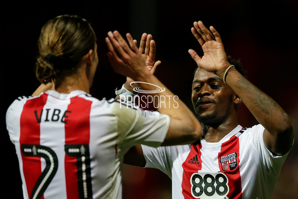 Lasses Vibe and Josh Clarke celebrate after scoring during the EFL Sky Bet Championship match between Brentford and Reading at Griffin Park, London, England on 27 September 2016. Photo by Jarrod Moore.
