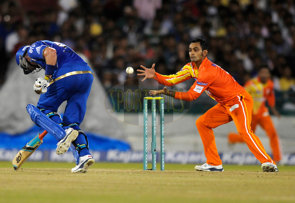 Mohammad Hafeez captain of Lahore Lions tries to collect a ball as Michael Hussey of Mumbai Indians runs to make it to the wicket during the qualifier 2 match of the Oppo Champions League Twenty20 between the Mumbai Indians and the Lahore Lions held at the Chhattisgarh International Cricket Stadium, Raipur, India on the 13th September 2014<br /> <br /> Photo by:  Pal Pillai / Sportzpics/ CLT20<br /> <br /> <br /> Image use is subject to the terms and conditions as laid out by the BCCI/ CLT20.  The terms and conditions can be downloaded here:<br /> <br /> <br /> http://sportzpics.photoshelter.com/gallery/CLT20-Image-Terms-and-Conditions-2014/G0000IfNJn535VPU/C0000QhhKadWcjYs