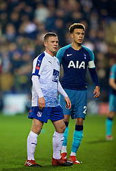 BIRKENHEAD, ENGLAND - Friday, January 4, 2019: Tranmere Rovers' Jay Harris and Tottenham Hotspur's Dele Alli during the FA Cup 3rd Round match between Tranmere Rovers FC and Tottenham Hotspur FC at Prenton Park. (Pic by David Rawcliffe/Propaganda)