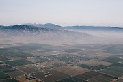 A layer of dust and smog hang over the Valley above the rural town of Arvin.