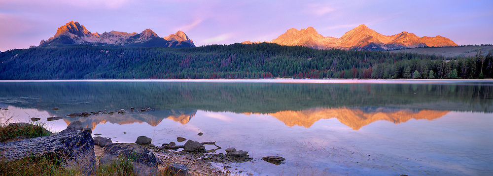 The Sawtooth peaks reflect into Redfish Lake, near it's outlet.