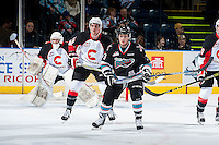 KELOWNA, CANADA - OCTOBER 23: Riley Stadel #3 of Kelowna Rockets looks for the pass against the Prince George Cougars on October 23, 2015 at Prospera Place in Kelowna, British Columbia, Canada.  (Photo by Marissa Baecker/Shoot the Breeze)  *** Local Caption *** Riley Stadel;