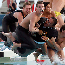 La Canada High School coach Art Lopez celebrates with his team after winning in the over-all during the Division II CIF Southern Section Swimming Championships at Mt. San Antonio College on Saturday, May 16, 2009, in Walnut,Calif. (Pasadena Star-News/Keith Birmingham)